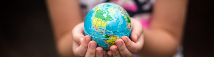Socially Responsible Investing - Ethical Investment Charities - girl holding the earth in her hands
